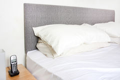 Bedside table and bed Royalty Free Stock Images