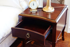 bedside table in bedroom Stock Images