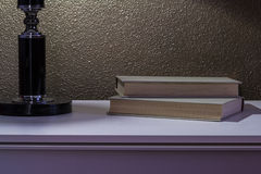 Bedside table with book Stock Image