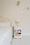 Bedside table with books Royalty Free Stock Images