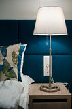 Bedside table lamp in bedroom detail Stock Images