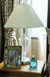 Bedside table with lamp and picture frame Stock Photo