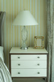 Bedside table with lamp Stock Photo