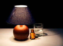 Bedside table lamp with tablets, water - insomnia maybe Stock Photography
