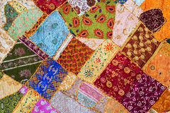 Bedspread patchwork in oriental style, closeup. Royalty Free Stock Photos