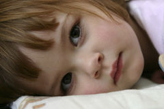 Bedtime. Little girl falling asleep in her bed Stock Photography