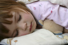 Bedtime. Little girl falling asleep in her bed Stock Photo