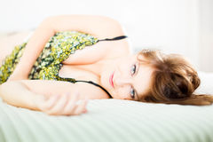 Bedtime. Glamour portrait of a beautiful woman in bed royalty free stock images