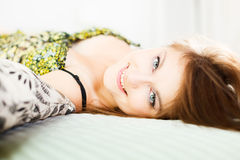 Bedtime. Glamour portrait of a beautiful woman in bed royalty free stock photos