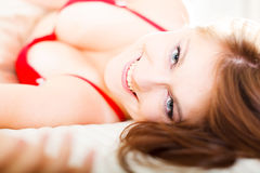 Bedtime. Glamour portrait of a beautiful woman in bed royalty free stock photo