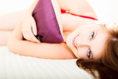 Bedtime. Glamour portrait of a beautiful woman in bed stock photography