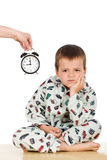 Bedtime for a displeased kid. In pajamas - isolated royalty free stock photos