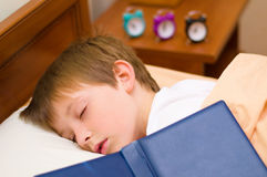 Bedtime for little schoolboy Royalty Free Stock Image