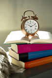 Bedtime reading, alarm clock and books Royalty Free Stock Photos