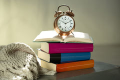 Bedtime reading, alarm clock and books Royalty Free Stock Photo