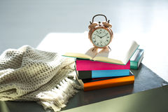 Bedtime reading, alarm clock and books Royalty Free Stock Photography