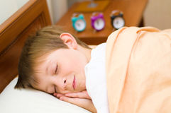 Bedtime for schoolboy Stock Images