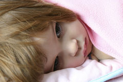 Bedtime (series II). Littl girl lying in bed just before falling asleep Royalty Free Stock Images