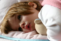 Bedtime (series II). Littl girl lying in bed just before falling asleep Stock Photography