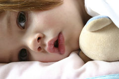Bedtime (series II). Littl girl lying in bed just before falling asleep Stock Photo