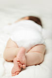 Bedtime - sleeping baby, feet Stock Image