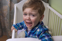 Bedtime tears. Little boy crying hysterically in his bed Royalty Free Stock Images