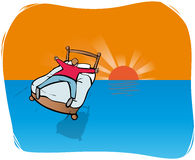 Bedtime traveller. Man on bed gliding over setting sun Royalty Free Stock Image
