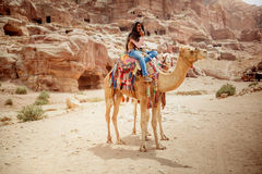 Beduin with camels in Petra. Beduin, the inhabitants the the region around Petra in the ancient site in Jordan stock photography