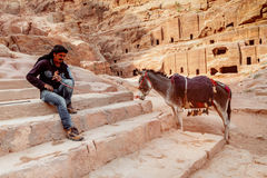 Beduin with donkey in Petra. Beduin, the inhabitants the the region around Petra in the ancient site in Jordan stock photos