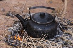 Bedouin tea. A pot of tea brewed Bedouin-style on open fire in the desert Royalty Free Stock Photography