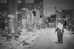 Beduin walks in the streets of Bosra. stock photo