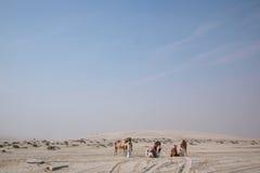 Beduino con el dromedario Foto de archivo libre de regalías
