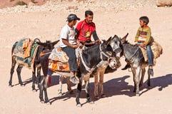 Beduins and donkeys at Petra in Jordan Stock Photos