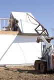 In bedwang houdend het dak Stock Fotografie