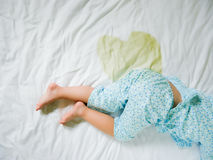 Bedwetting: Child pee on a mattress,Little girl feet and pee in bed sheet,Child development concept ,selected focus at. Bedwetting ,Child pee on a mattress Stock Images
