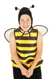 Bee. Lady sitting posing for the camera in a bee costume. White background Stock Photo