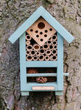This bee box protects overwintering solitary bees. Stock Image
