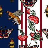 Bee, butterfly, beetle and flowers embroidery. Stock Photography