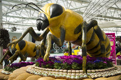 The bee. Cartoon big bee flower bed Royalty Free Stock Photo