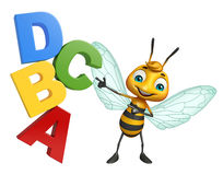 Bee cartoon character with ABCD sign. 3d rendered illustration of Bee cartoon character with ABCD sign Stock Photos