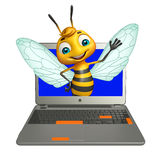 Bee cartoon character with laptop Royalty Free Stock Photos