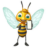 Bee cartoon character  with mobile Stock Images