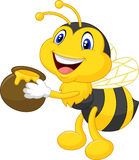 Bee cartoon holding honey bucket Royalty Free Stock Images