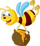 Bee cartoon holding honey bucket Royalty Free Stock Photo