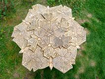 Bee carving. Bees in a honeycomb carved out of wood Stock Image