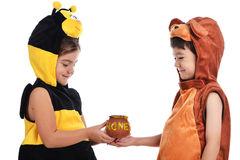 Bee costume and bear costume Stock Images