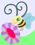 A Bee and a Flower. Cute bee flying near the flower stock photography