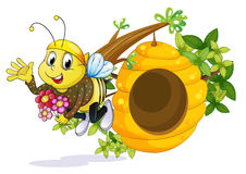 A bee with flowers near the beehive Stock Photography