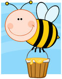 Bee Flying With A Honey Bucket Stock Image