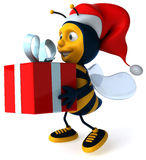 Bee and gift Royalty Free Stock Photo